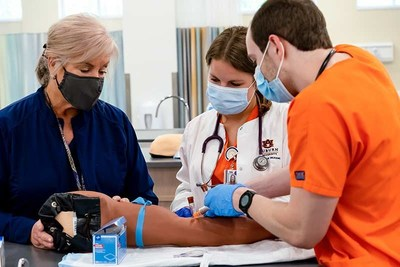 Auburn University faculty in its School of Nursing, like Karol Renfroe, left, had to alter how they provide instruction and offer clinical opportunities for students because of the COVID-19 pandemic. Many Auburn nursing alumni have been on the front lines since the pandemic began, forcing them to adapt how best to care for patients while keeping themselves and others safe.